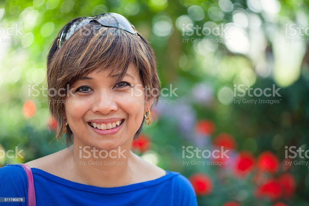 Garden portrait of a smiling woman stock photo