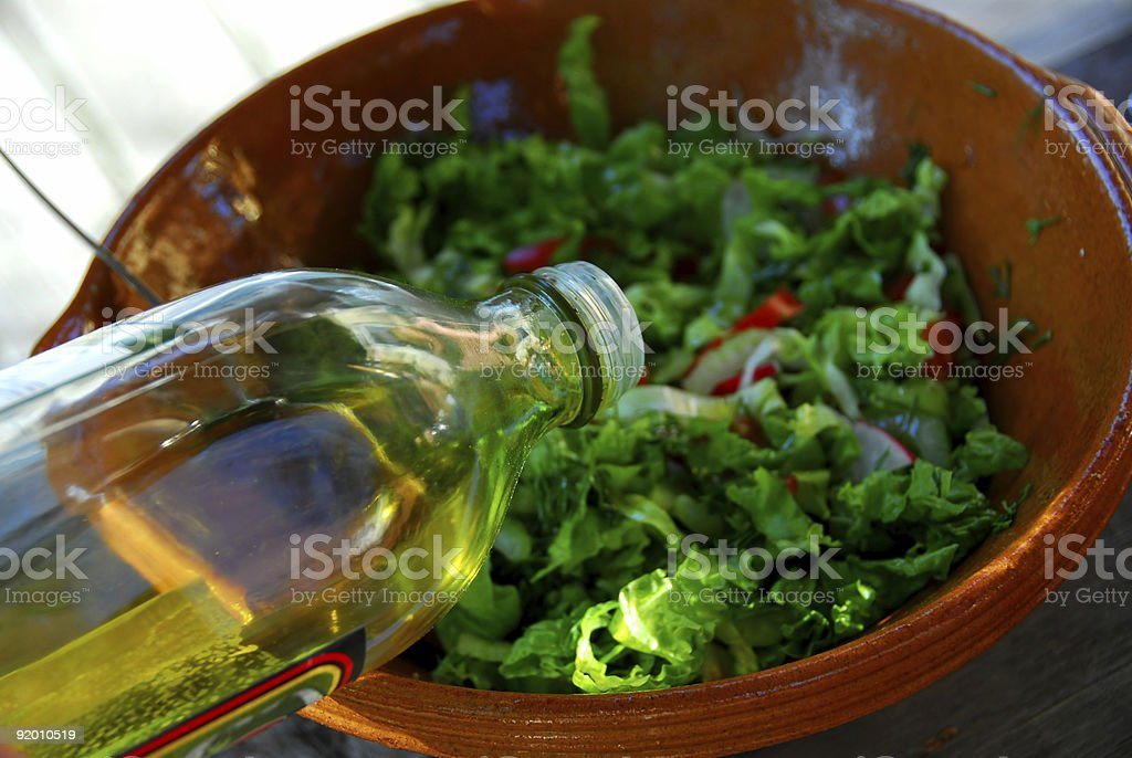 Garden salad and olive oil royalty-free stock photo