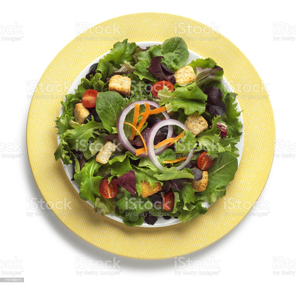 Garden salad on yeloow plate isolated on a white background stock photo