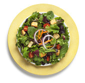 Garden salad on yeloow plate isolated on a white background