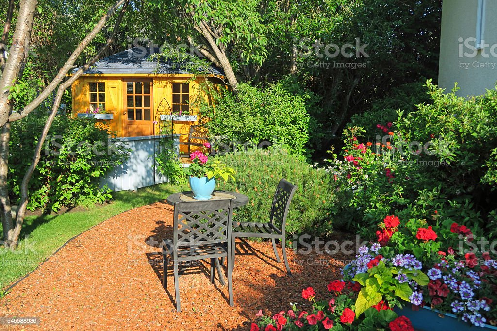 Garden shed in a flower garden with roses- from above stock photo