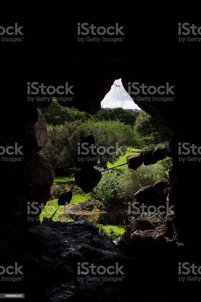 Garden through the Cave royalty-free stock photo