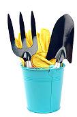 garden tools and blue bucket