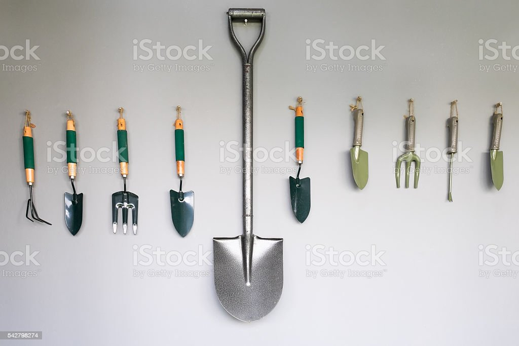 Garden tools hanging. stock photo