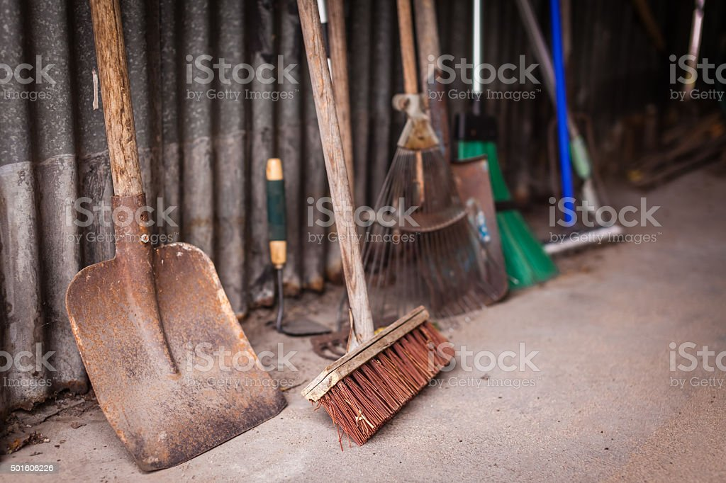 Garden tools in a shed stock photo