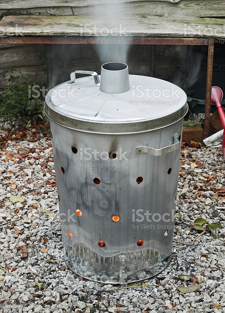 Garden waste incinerator bin stock photo