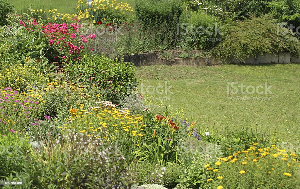 Garden with flowers and herbs royalty-free stock photo