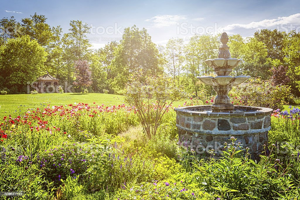 Garden with fountain and gazebo stock photo