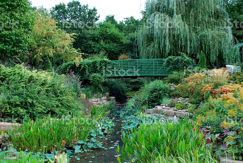 Garden with Green Bridge stock photo