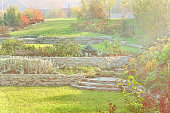 Garden with lawns, retaining walls, alpine slide in the fall
