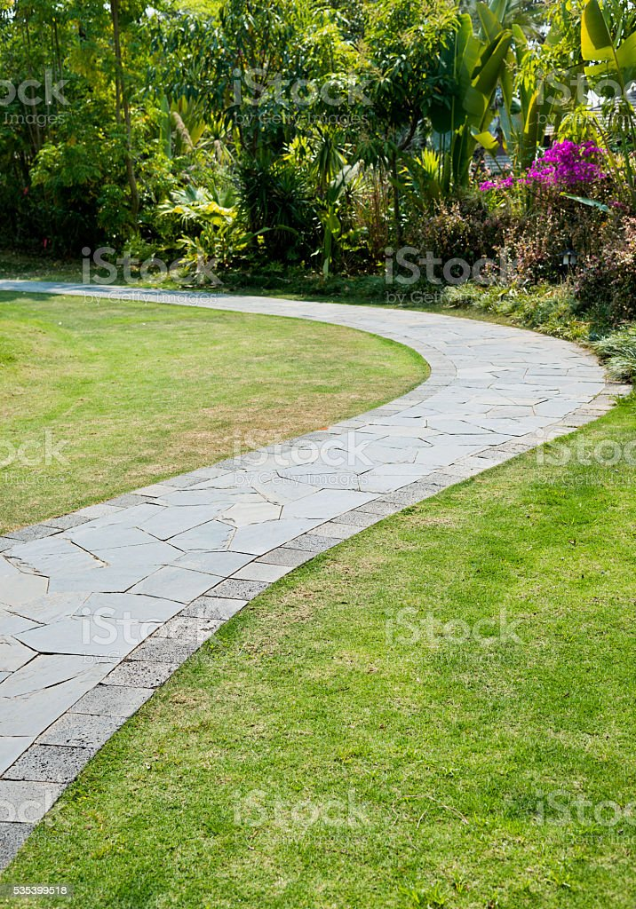 Garden with paving stone walkway stock photo