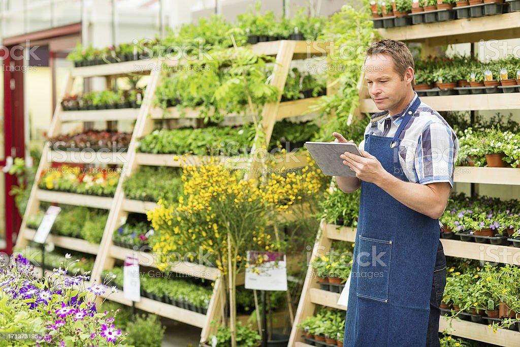 Garden Worker Using Digital Tablet stock photo