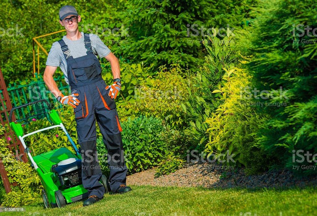 Gardener Grass Mowing stock photo