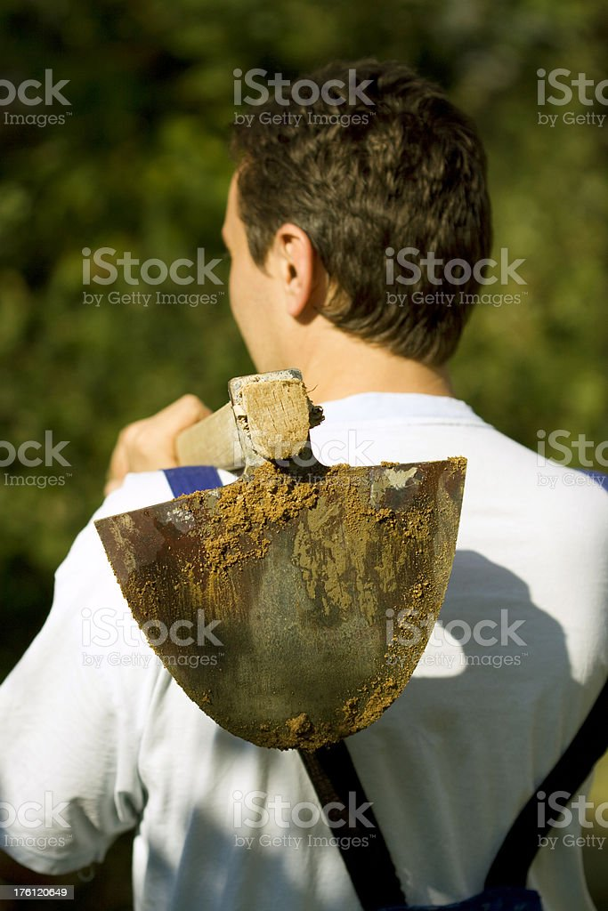 gardener holding hoe royalty-free stock photo