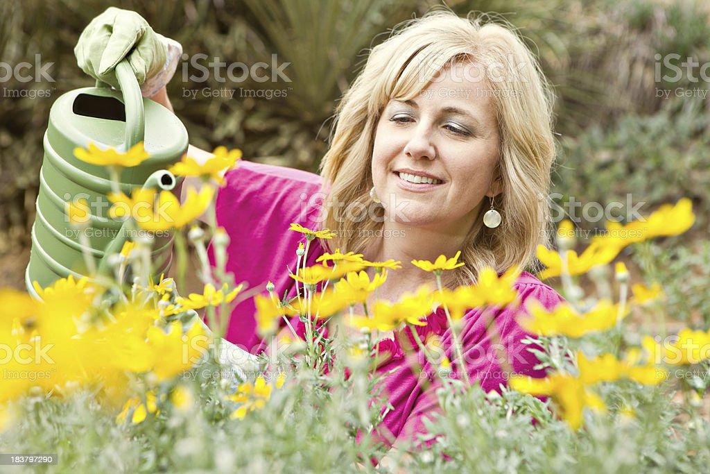 gardener watering flowers smiling royalty-free stock photo