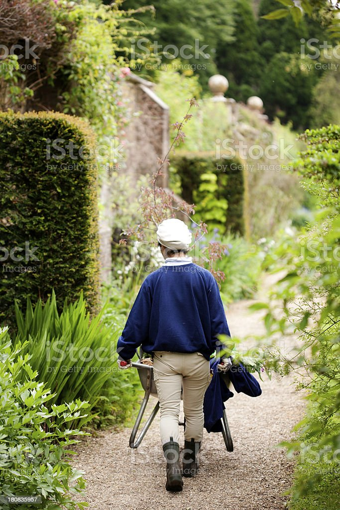 Gardener with barrow stock photo