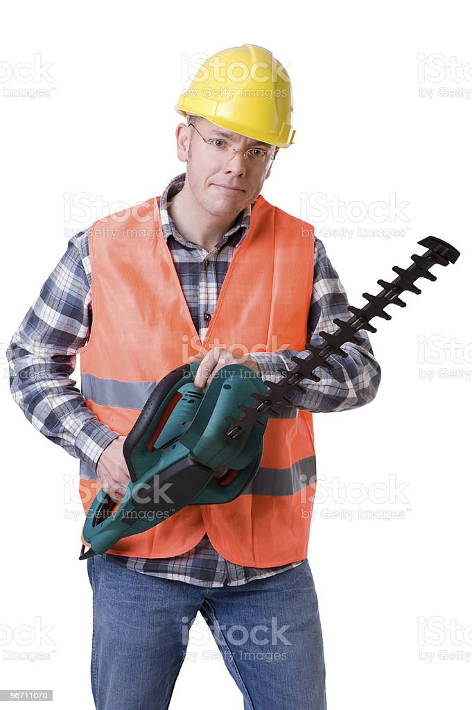 Gardener with hedge trimmer royalty-free stock photo