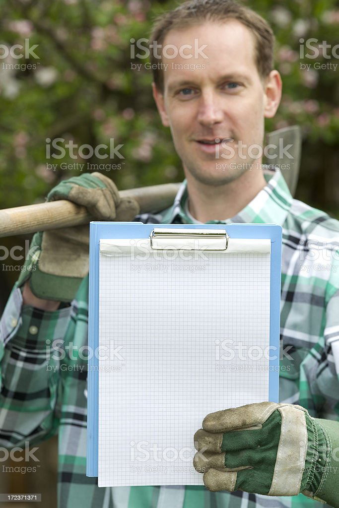 Gardener with piece of paper, copyspace royalty-free stock photo