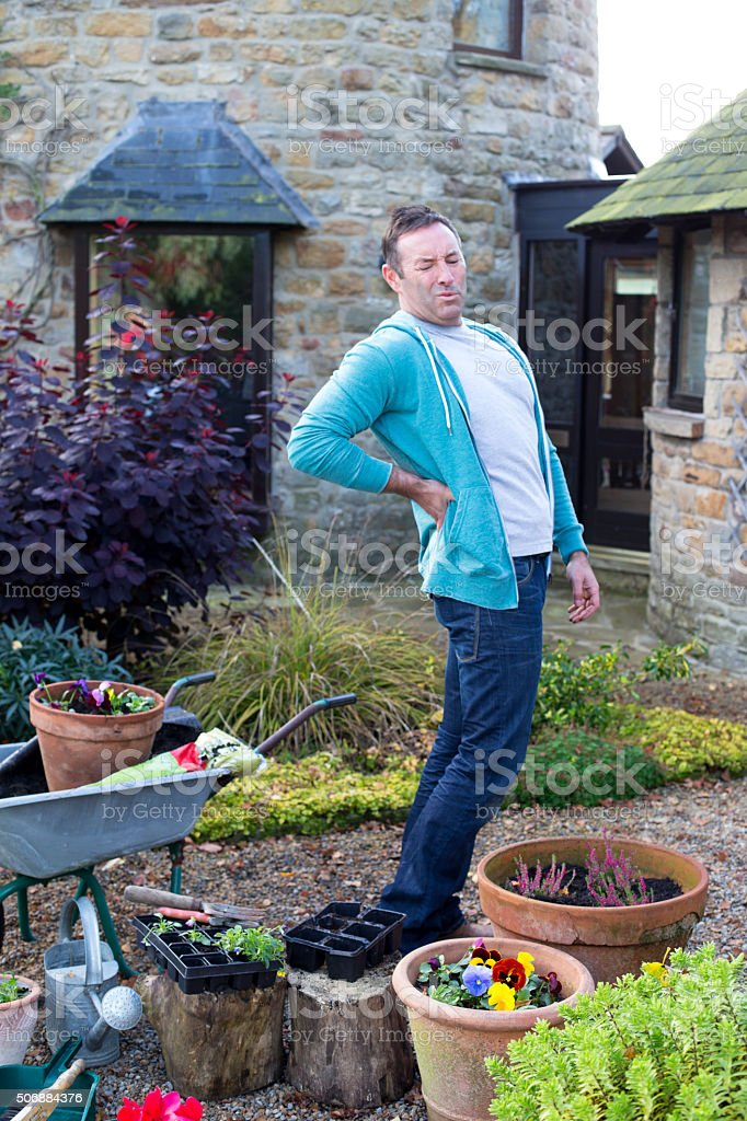 Gardening can be back breaking! stock photo