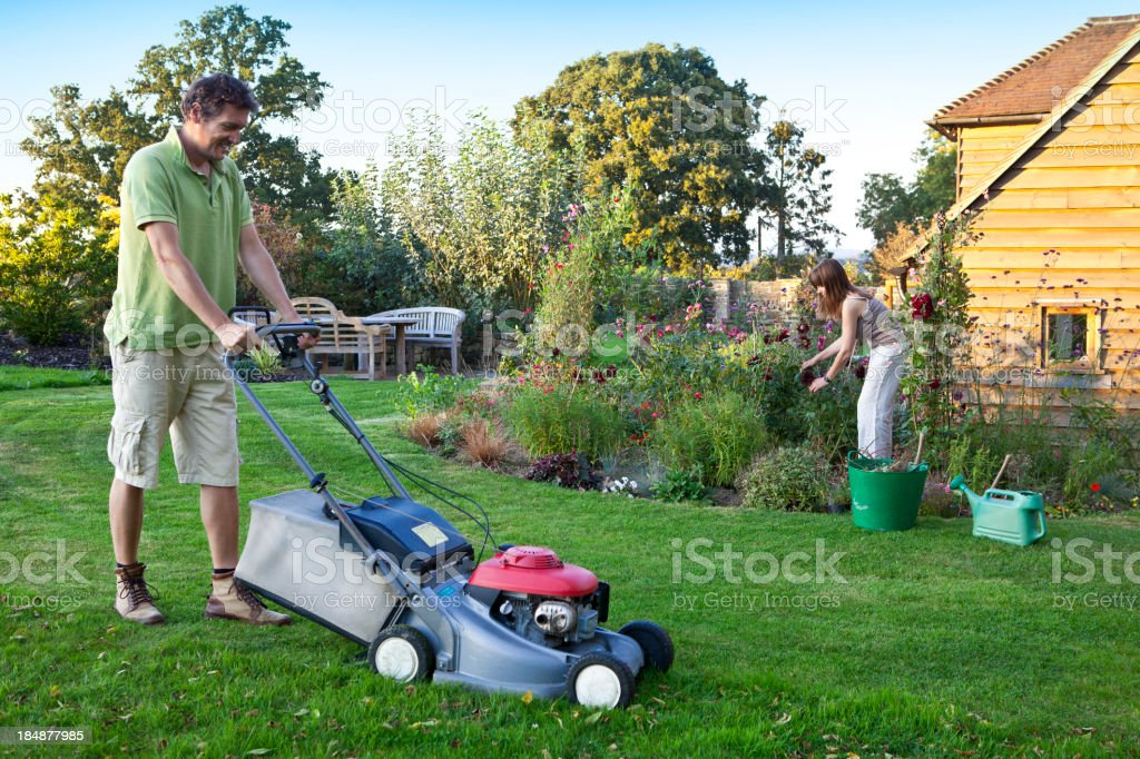 Gardening Couple Mowing and Pruning stock photo