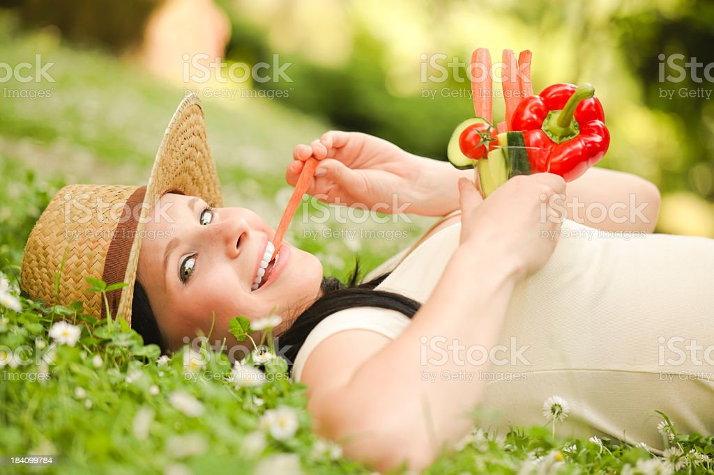 Gardening series: young woman eating healthy snacks royalty-free stock photo