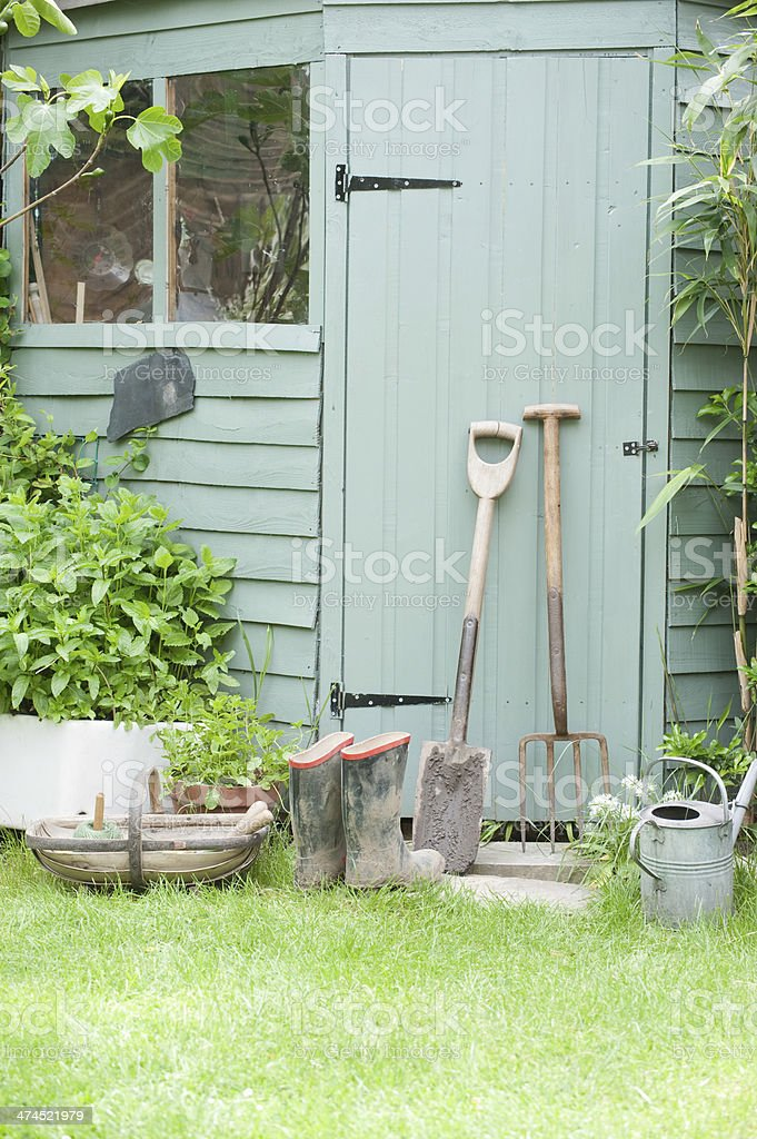 Gardening Tools Against Door Of Shed stock photo