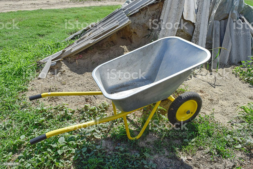 Gardening wheelbarrow for transportation of sand and earth stock photo