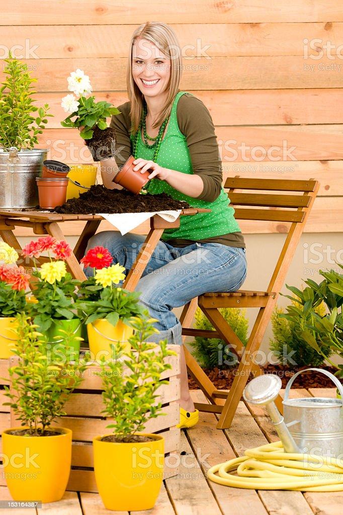 Gardening woman plant spring flower terrace royalty-free stock photo