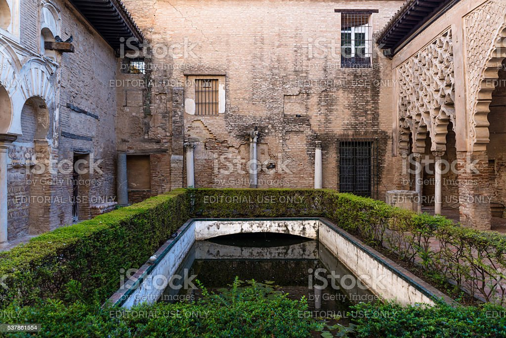 Gardens and pond in the Alcazar of Seville stock photo