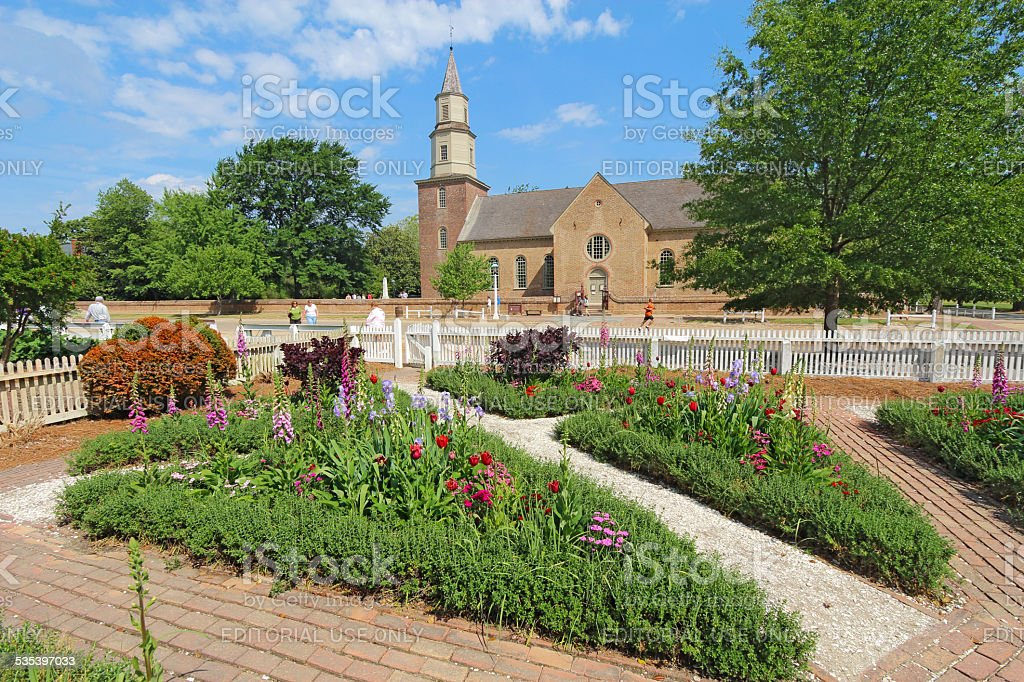 Gardens at Colonial Williamsburg in front of Bruton Parish Churc stock photo