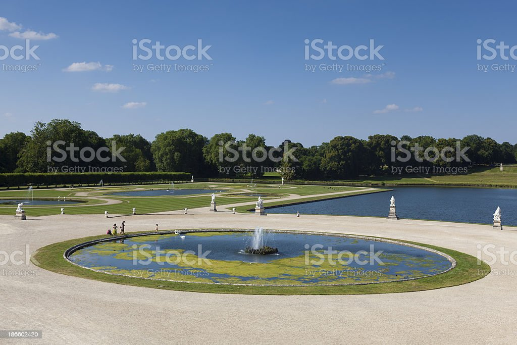 Gardens of Chantilly castle stock photo