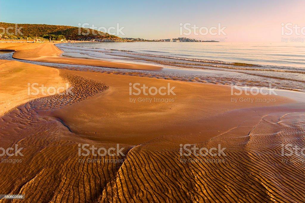 SUMMER. Gargano coast: low tide at dawn. Vieste (Puglia)- ITALY- stock photo