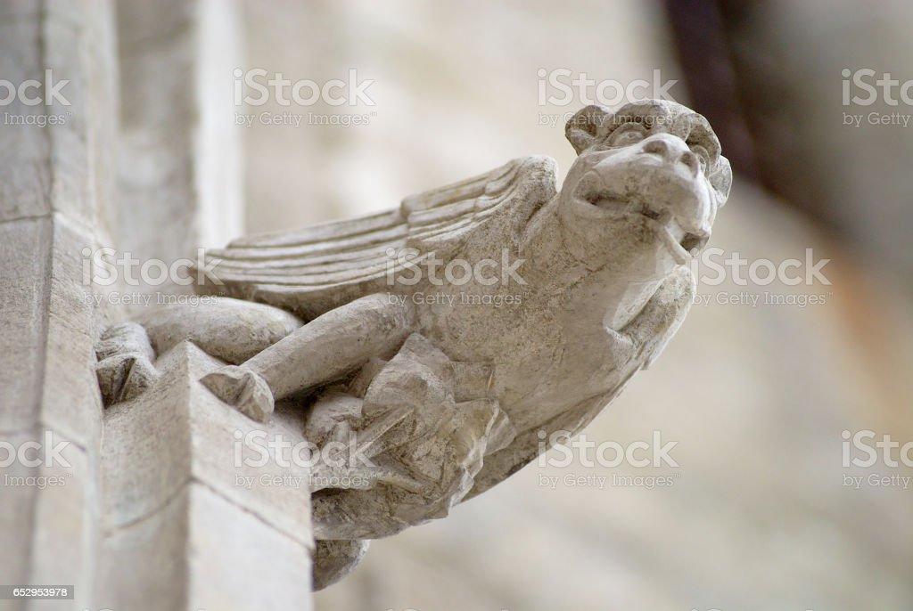 Gargoyle at the  Basilique Saint-Nazaire-et-Saint-Celse in Carcassonne, France. stock photo
