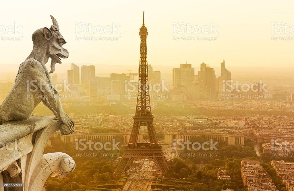 Gargoyle figur on Notre Dame looking towards Eiffel Tower stock photo