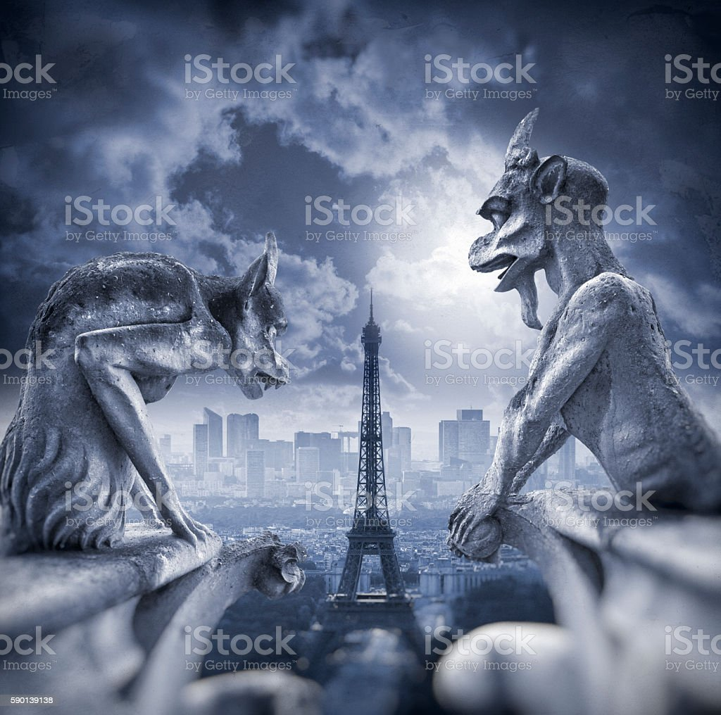 Gargoyle figur on Notre Dame with Eiffel Tower at night stock photo