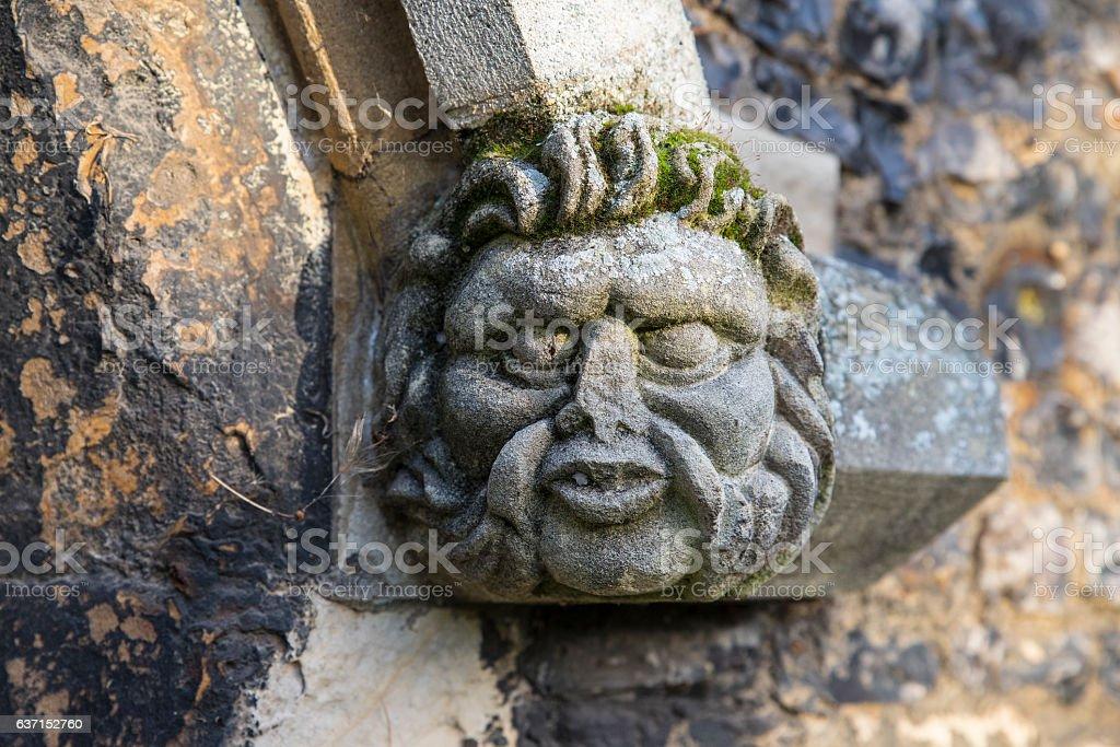 Gargoyle on Waltham Abbey Church stock photo
