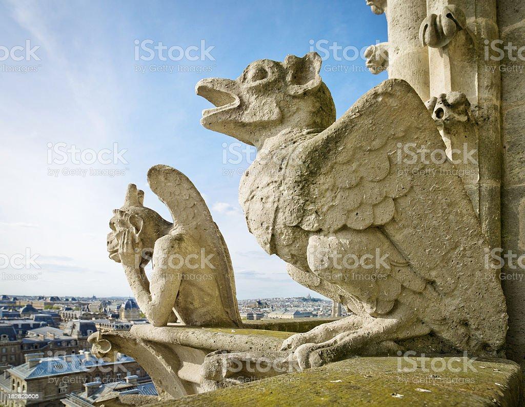 Gargoyle pair - Notre Dame, Paris stock photo