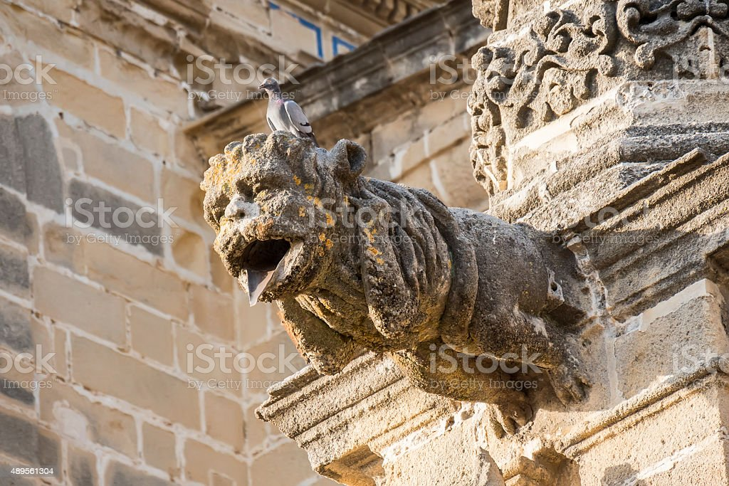 Gargoyle protruding from the facade of a cathedral stock photo