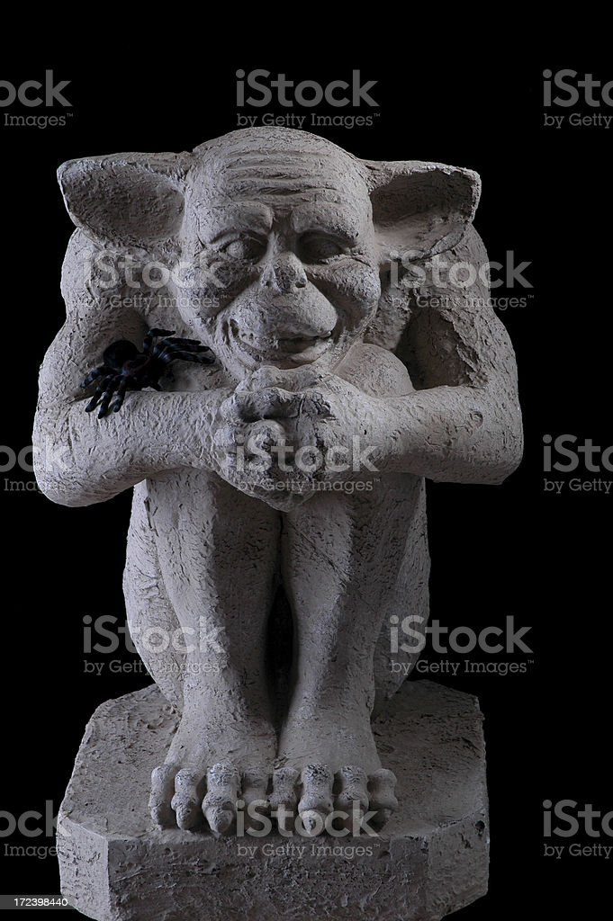 Gargoyle with dramatic lighting royalty-free stock photo