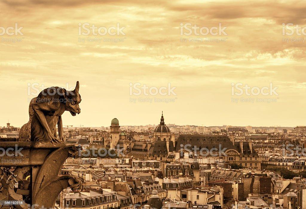 Gargoyles of Cathedral of Notre Dame de Paris overlooking Paris stock photo