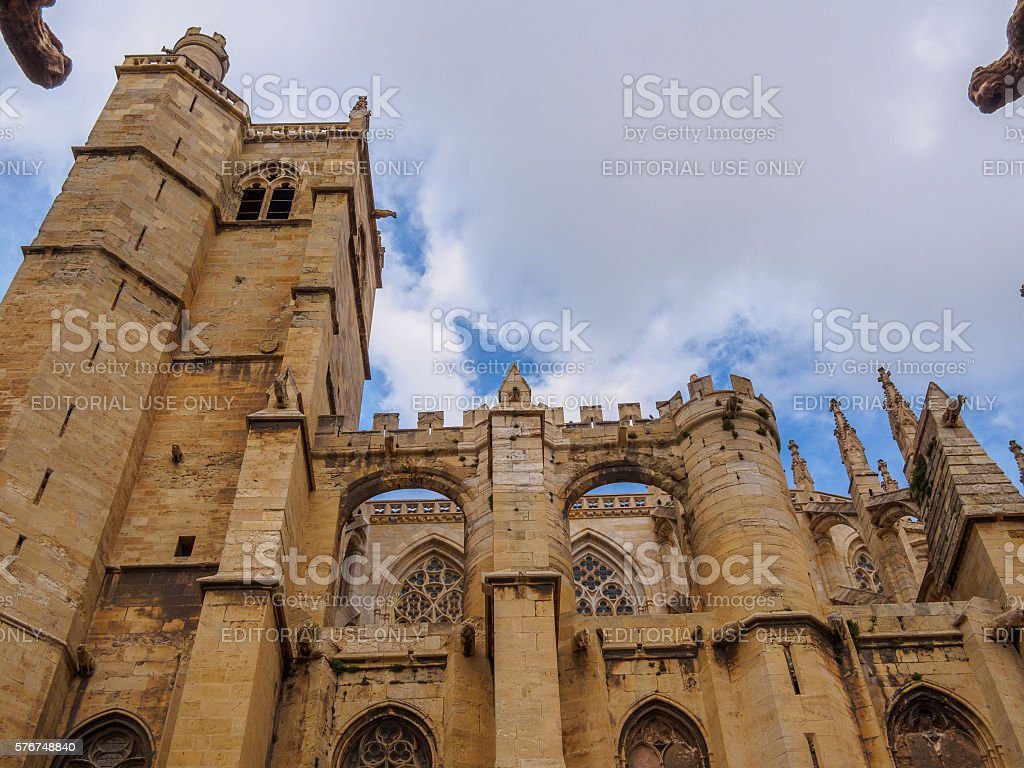 Gargoyles protecting the cathedral of Narbonne in a cloudy day stock photo