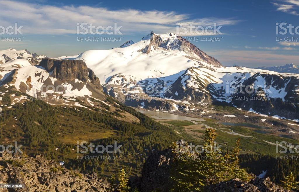 Garibaldi Massif from summit of Mount Price above Garibaldi Lake in BC Coast Mountains stock photo