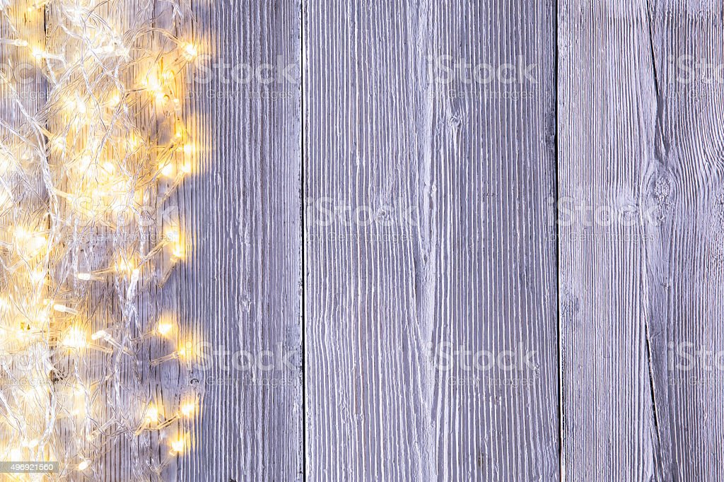 Garland Lights Wood Background, Wooden Board Texture Holiday Light stock photo