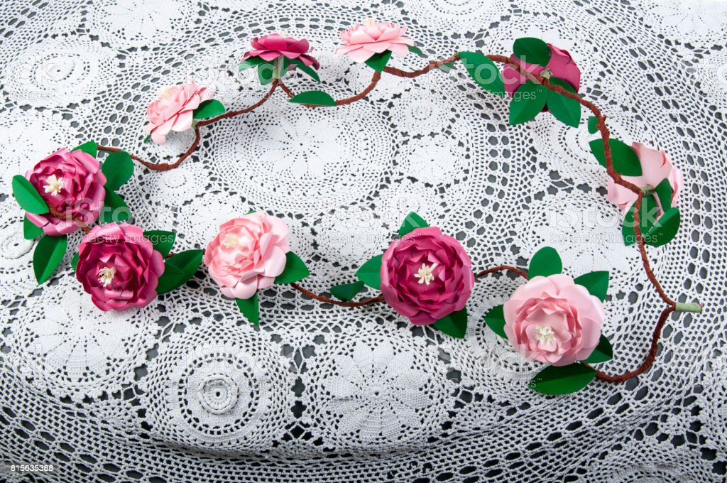 garland of decorative hand made paper camelia flowers stock photo