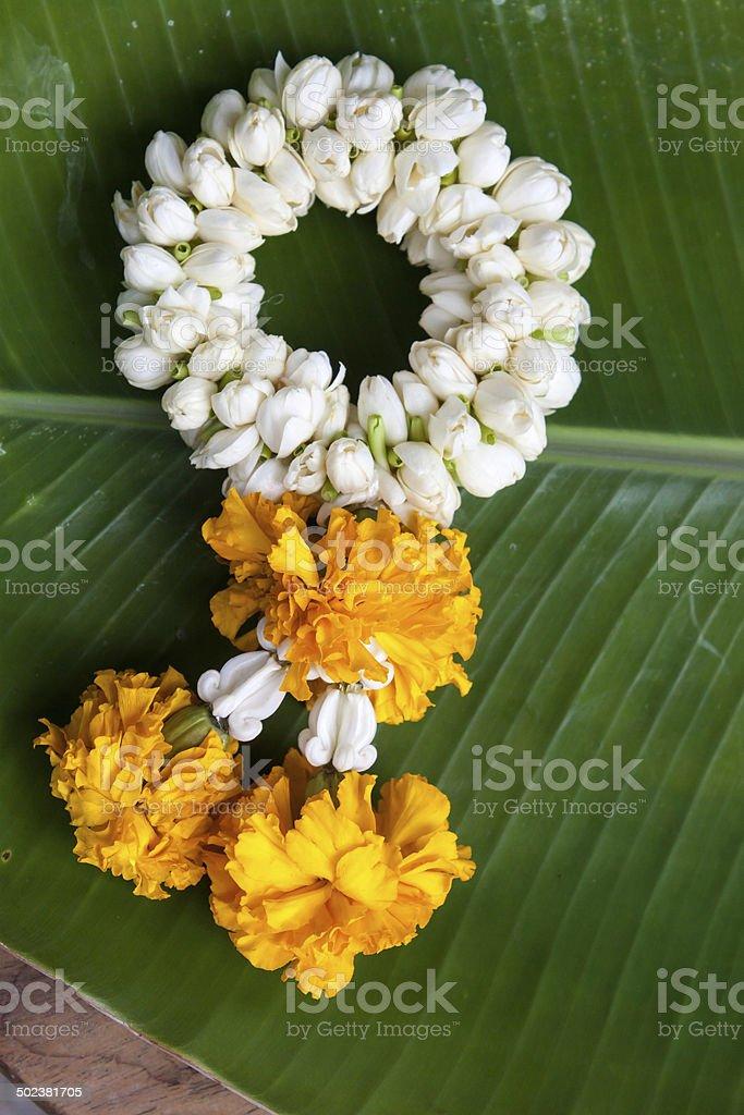 Garland of Jasmine with marigold bouquet stock photo