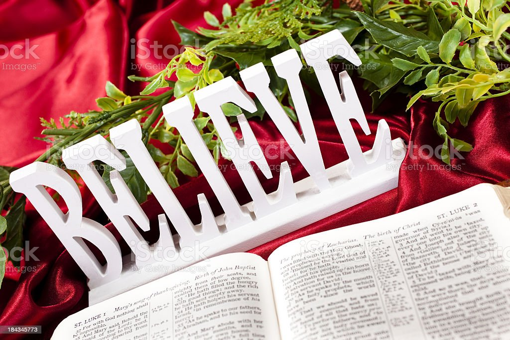 Garland with open Bible and BELIEVE sign royalty-free stock photo