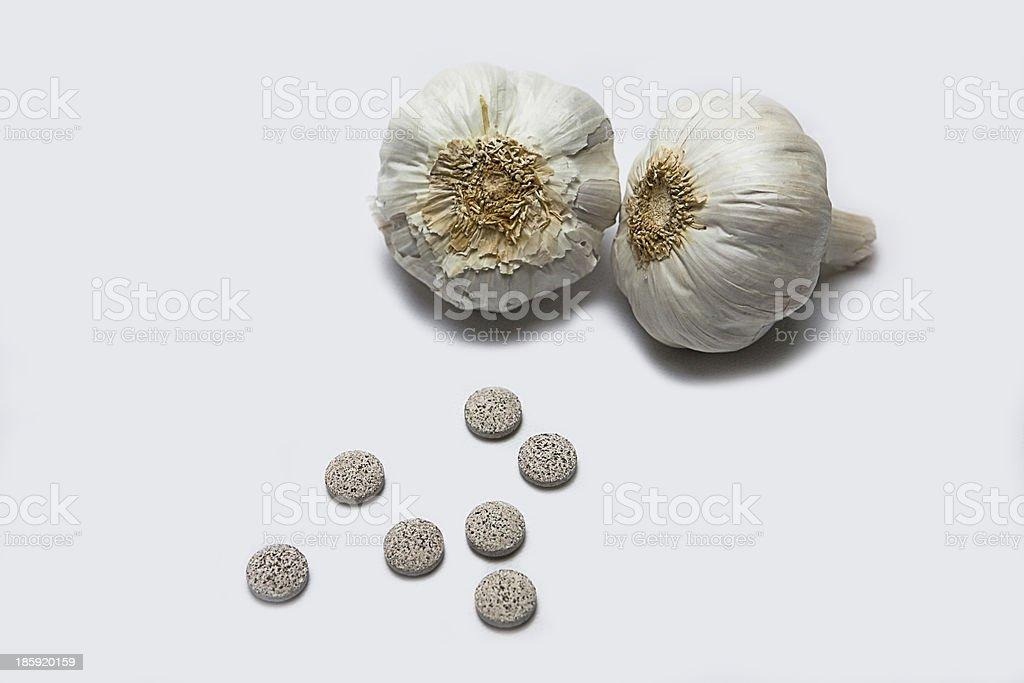 Garlic and herbal supplement pills, alternative medicine concept stock photo