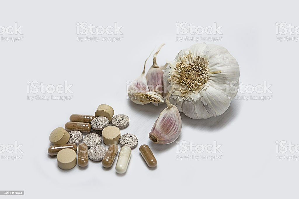 Garlic and herbal supplement pills, alternative medicine concept royalty-free stock photo