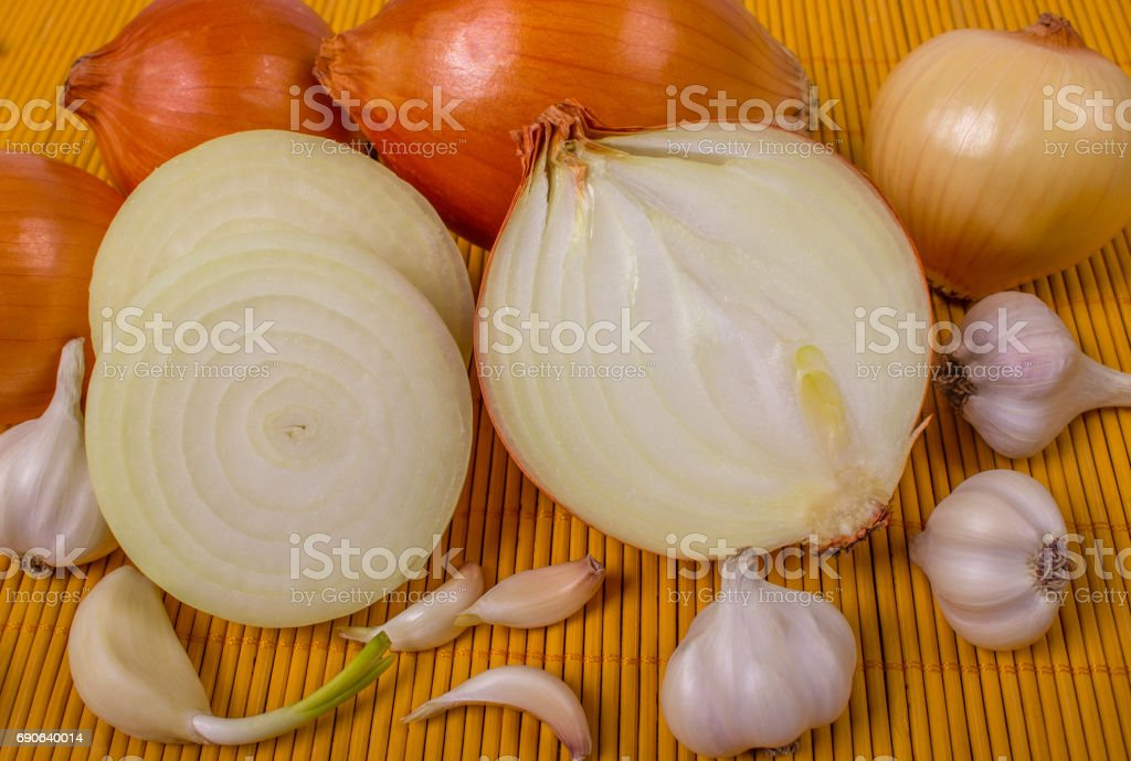 Garlic and onion on board. stock photo