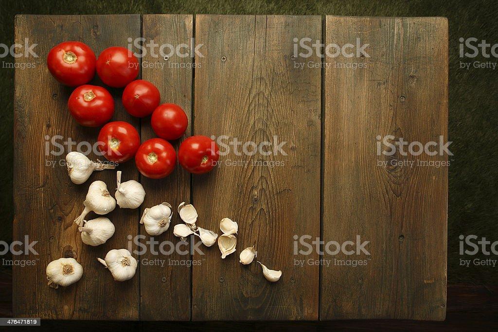 Garlic and tomatoes royalty-free stock photo